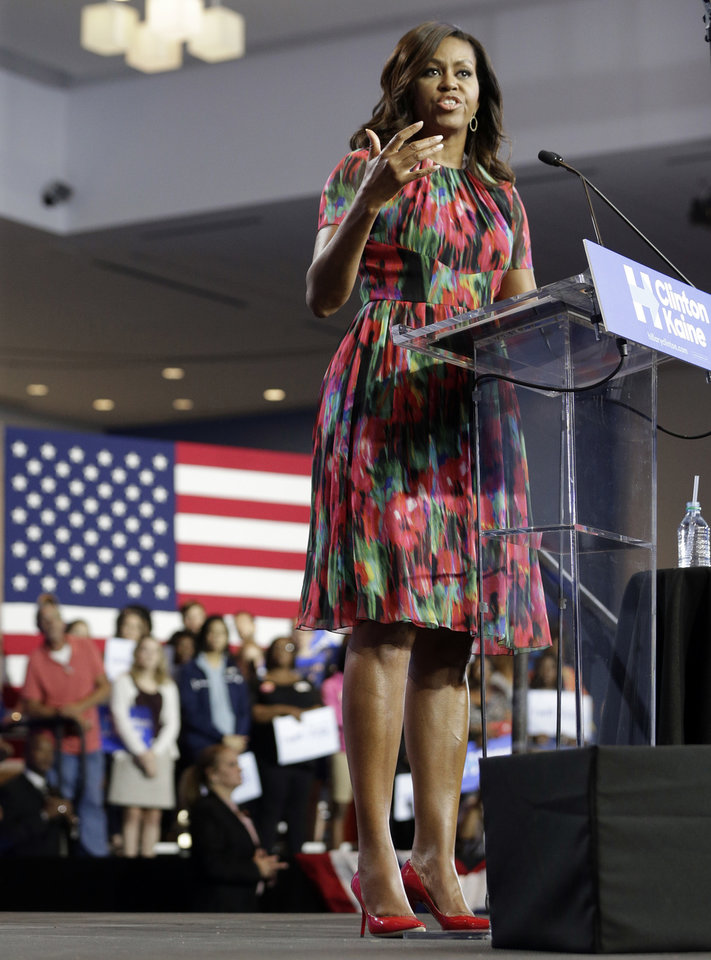 Photo - First lady Michelle Obama speaks during a campaign rally for Democratic presidential candidate Hillary Clinton,  Tuesday, Oct. 4, 2016, in Charlotte, N.C. (AP Photo/Chuck Burton)