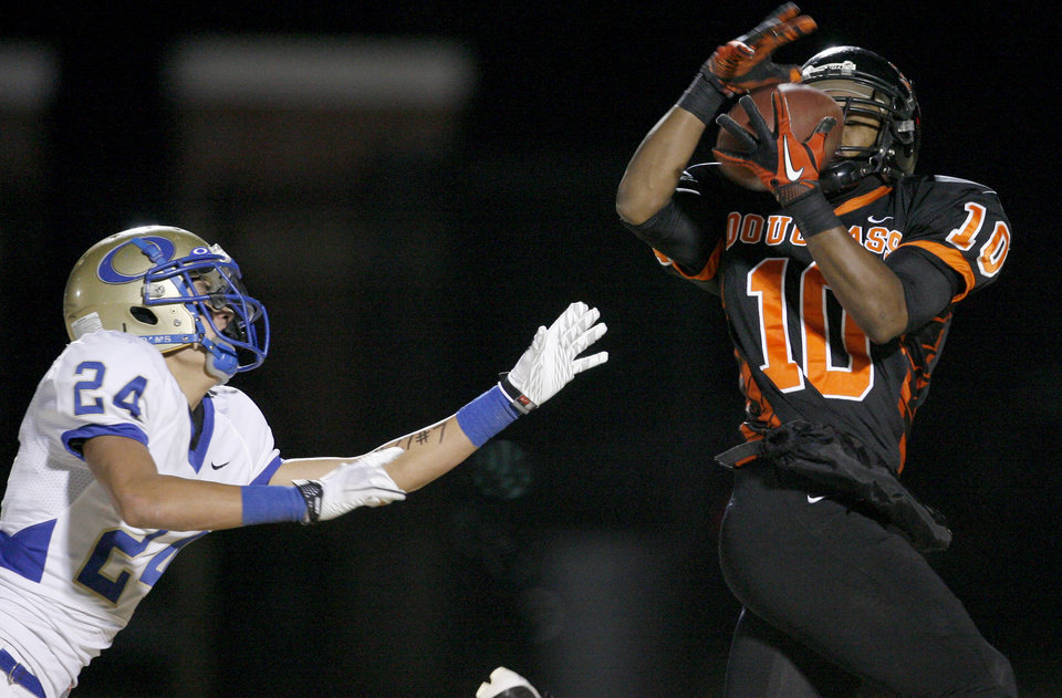 Douglass' Donnell Ward catches a touchdown pass in front of Oologah's Cody Brunk during a high school football playoff game in Oklahoma City, Friday, Nov. 19, 2010.  Photo by Bryan Terry, The Oklahoman