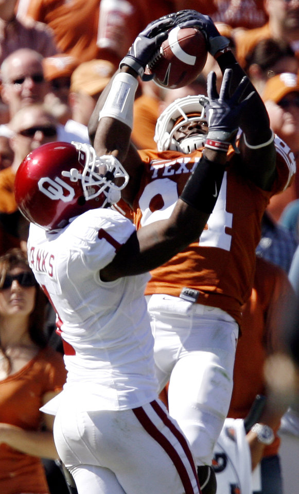 Photo - Oklahoma's Dominique Franks (1) breaks up a pass for Texas' Marquise Goodwin (84) during the Red River Rivalry college football game between the University of Oklahoma Sooners (OU) and the University of Texas Longhorns (UT) at the Cotton Bowl in Dallas, Texas, Saturday, Oct. 17, 2009. Photo by Chris Landsberger, The Oklahoman