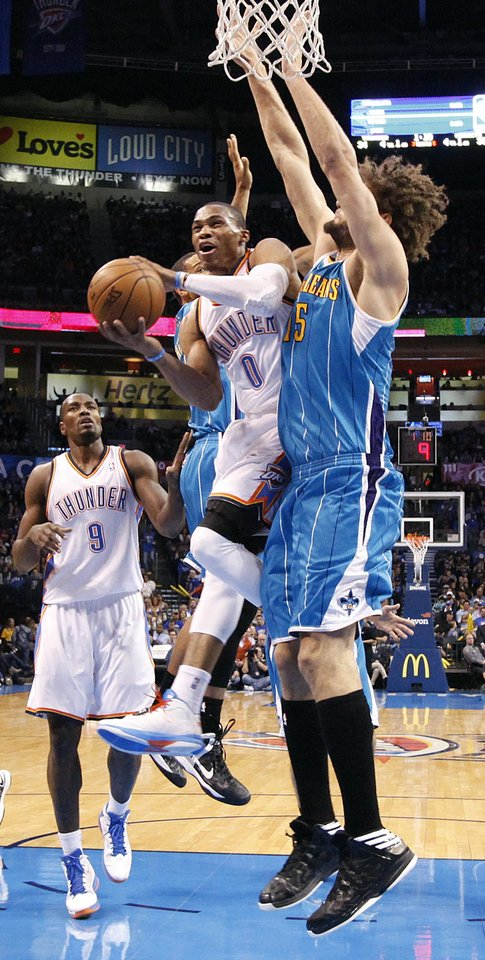 Oklahoma City Thunder's Russell Westbrook (0) drives past New Orleans Hornets' Robin Lopez (15) during the NBA basketball game between the Oklahoma CIty Thunder and the New Orleans Hornets at the Chesapeake Energy Arena on Wednesday, Dec. 12, 2012, in Oklahoma City, Okla.   Photo by Chris Landsberger, The Oklahoman