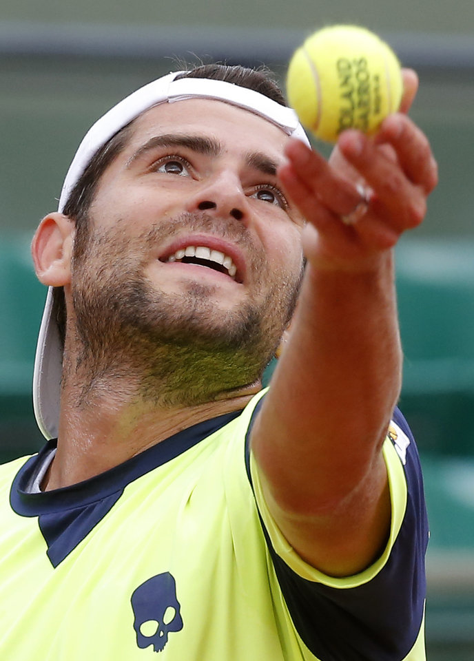 Photo - Italy's Simone Bolelli serves the ball to Spain's David Ferrer during their second round match of  the French Open tennis tournament at the Roland Garros stadium, in Paris, France, Thursday, May 29, 2014. (AP Photo/Michel Euler)
