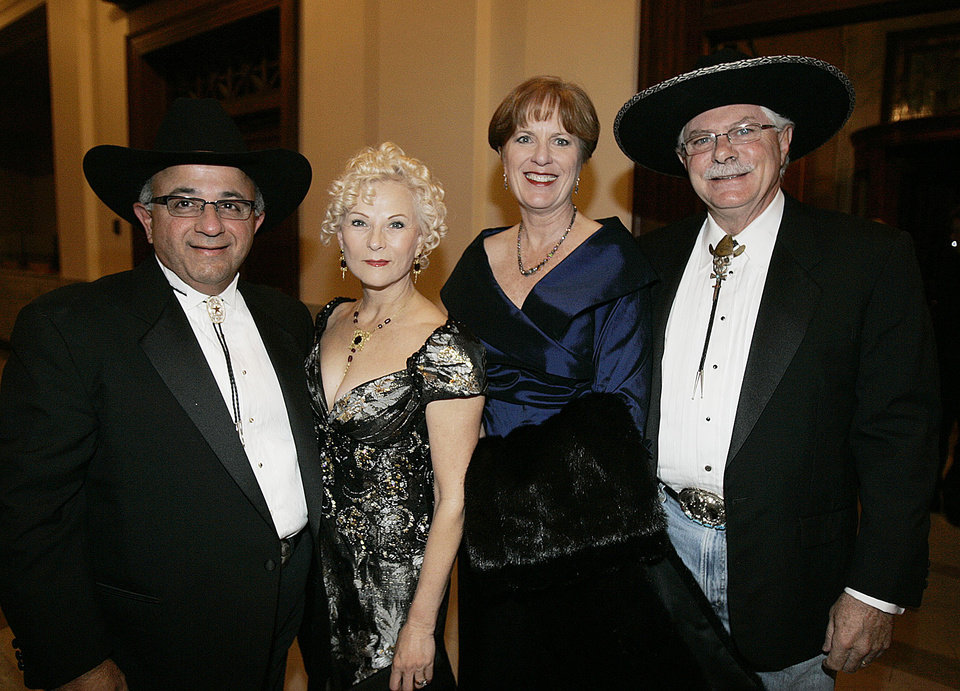 Photo - Frank and Saundra Naifeh of Edmond, left, and Dana and Randal Shadid attend the Oklahoma Centennial Statehood Inaugural Ball, Saturday, Nov. 17, 2007, at the Guthrie Scottish Rite Masonic Center, in Guthrie, Okla. By Bill Waugh, The Oklahoman