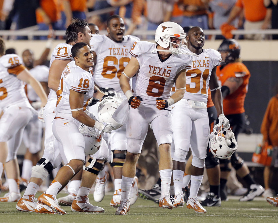 Photo - Texas celebrates their win over Oklahoma State following a college football game between Oklahoma State University (OSU) and the University of Texas (UT) at Boone Pickens Stadium in Stillwater, Okla., Saturday, Sept. 29, 2012. Texas on 41-36. Photo by Sarah Phipps, The Oklahoman