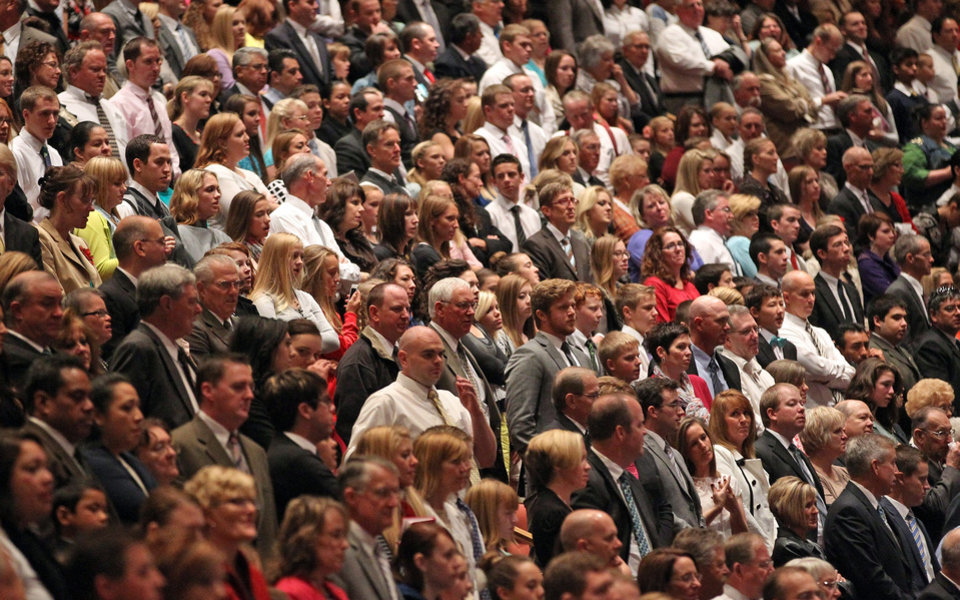 Photo - People look on during opening session of the two-day Mormon church conference Saturday, Oct. 5, 2013, in Salt Lake City. The president of the Mormon church says worldwide membership has hit 15 million, representing a three-fold increase over the three decades. President Thomas S. Monson announced the milestone during the opening session of the two-day Mormon church conference Saturday morning. The biannual general conference of The Church of Jesus Christ and Latter-day Saints brings 100,000 members to Salt Lake City. More than half of church members live outside of the United States. (AP Photo/Rick Bowmer)
