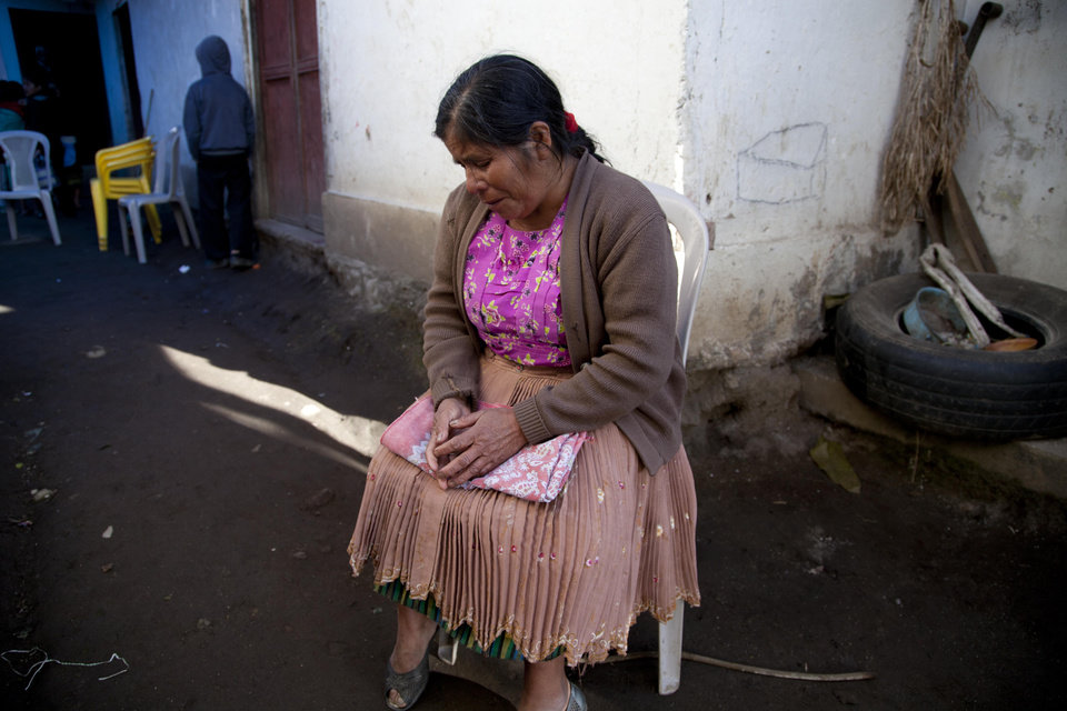 Zoila Gomez grieves outside the room where the wake is taking place for members of the Vasquez family who were buried alive when their house collapsed in San Cristobal Cucho, Guatemala, Thursday, Nov. 8, 2012. The family died when a magnitude 7.4 earthquake struck on Wednesday, collapsing the home of the Vasquez family and burying 10 of them, including a 4-year-old child, in the rubble. The quake killed at least 52 people and left dozens more missing. (AP Photo/Moises Castillo) ORG XMIT: GUA119
