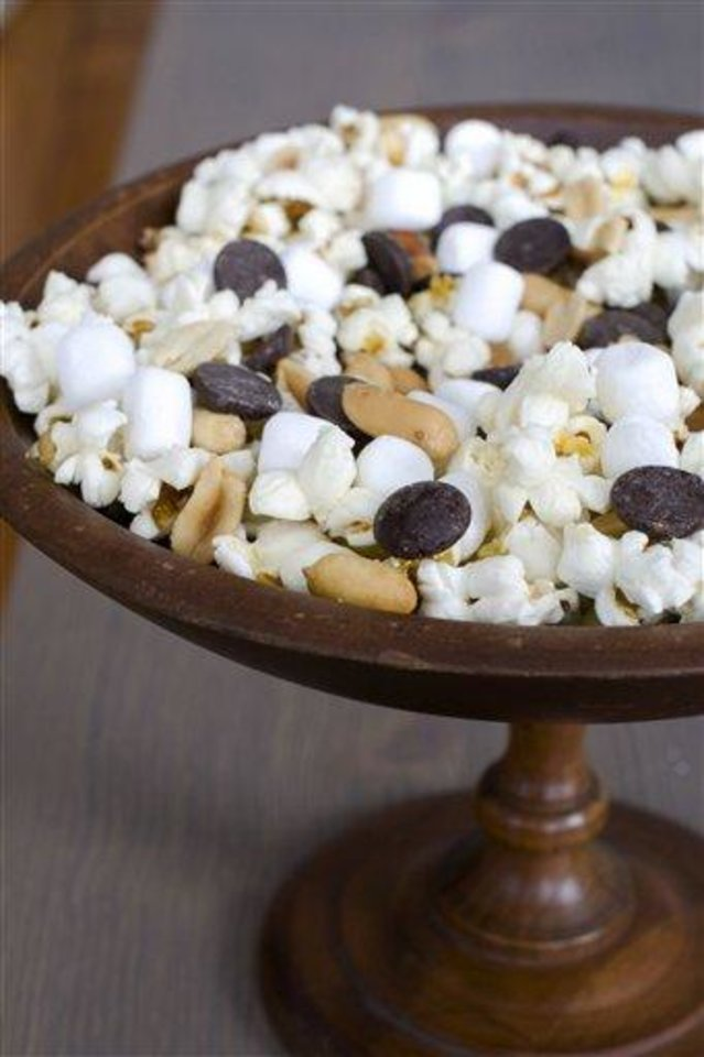 Photo - In this image taken on Jan. 28, 2013, the recipe for Stovetop Popcorn Many Ways with mini marshmallows, chocolate chips and salted peanuts is shown in Concord, N.H. (AP Photo/Matthew Mead)