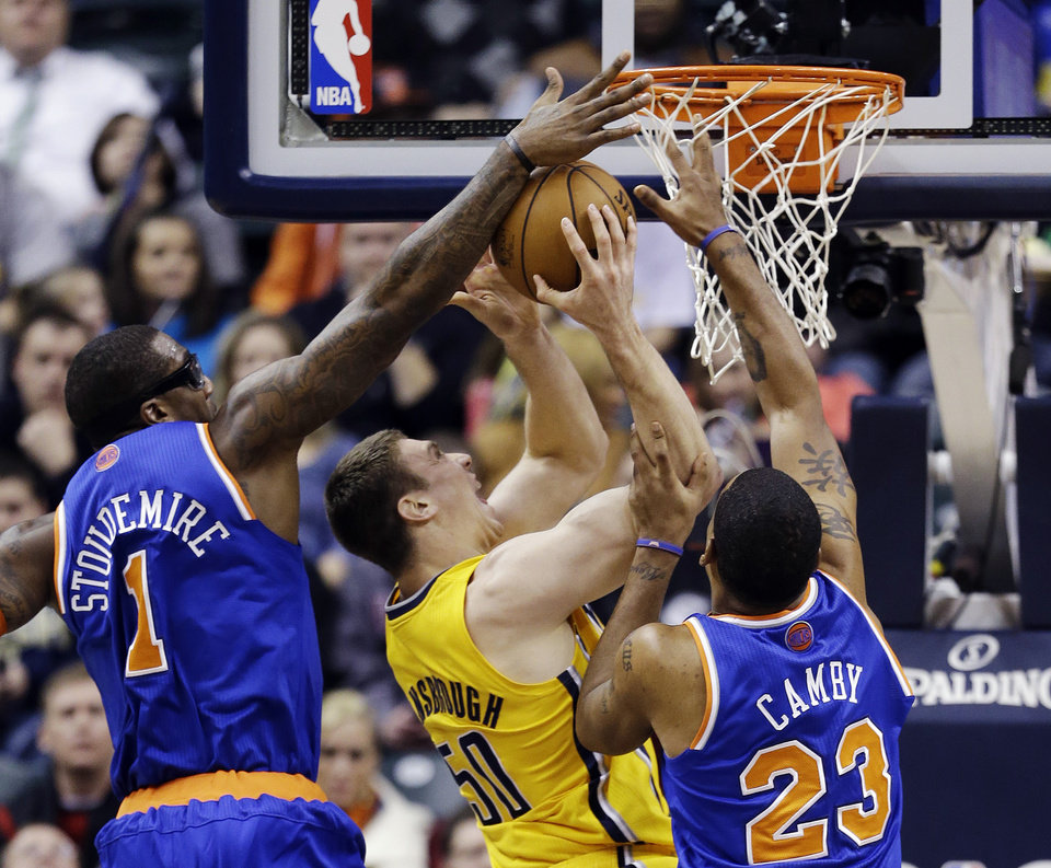 Indiana Pacers' Tyler Hansbrough (50) shoots against New York Knicks' Amare Stoudemire (1) and Marcus Camby (23) during the first half of an NBA basketball game, Thursday, Jan. 10, 2013, in Indianapolis. (AP Photo/Darron Cummings)