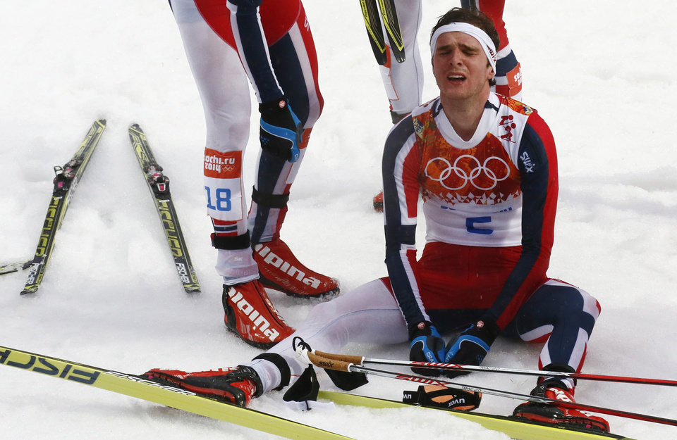 Photo - Norway's Joergen Graabak catches his breath after winning the gold during the Nordic combined individual Gundersen large hill competition at the 2014 Winter Olympics, Tuesday, Feb. 18, 2014, in Krasnaya Polyana, Russia. (AP Photo/Dmitry Lovetsky)