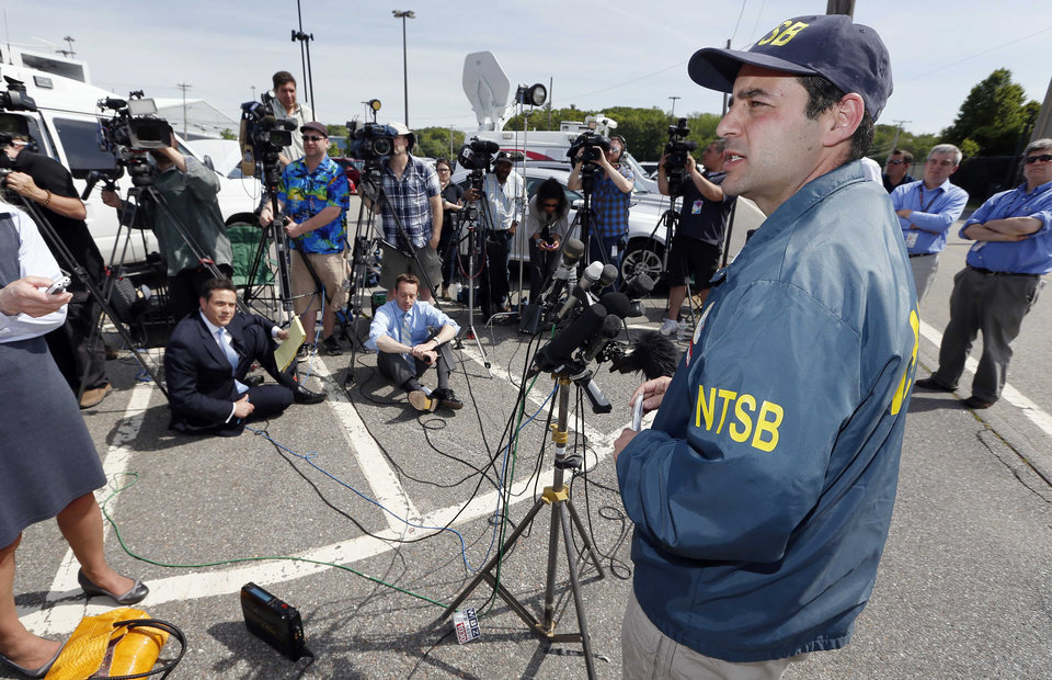 Photo - National Transportation Safety Board senior air safety investigator Luke Schiada speaks during a news conference at Hanscom Field in Bedford, Mass., Sunday, June 1, 2014. The co-owner of the Philadelphia Inquirer newspaper, Lewis Katz, was killed along with six other people in a fiery plane crash in Massachusetts, just days after reaching a deal that many hoped would end months of infighting at the newspaper and help restore it to its former glory. (AP Photo/Michael Dwyer)