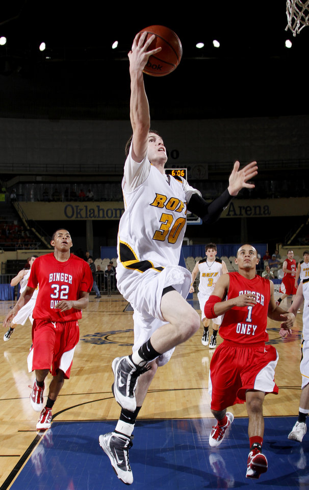 Photo - Roff's Aaron Cornell scores a basket as Binger-Oney's Jordan Cisco, left, and Tevin Johnson watch during the Class B boys basketball state tournament at the State Fair Arena in Oklahoma City, Friday, March 5, 2010.  Photo by Bryan Terry, The Oklahoman