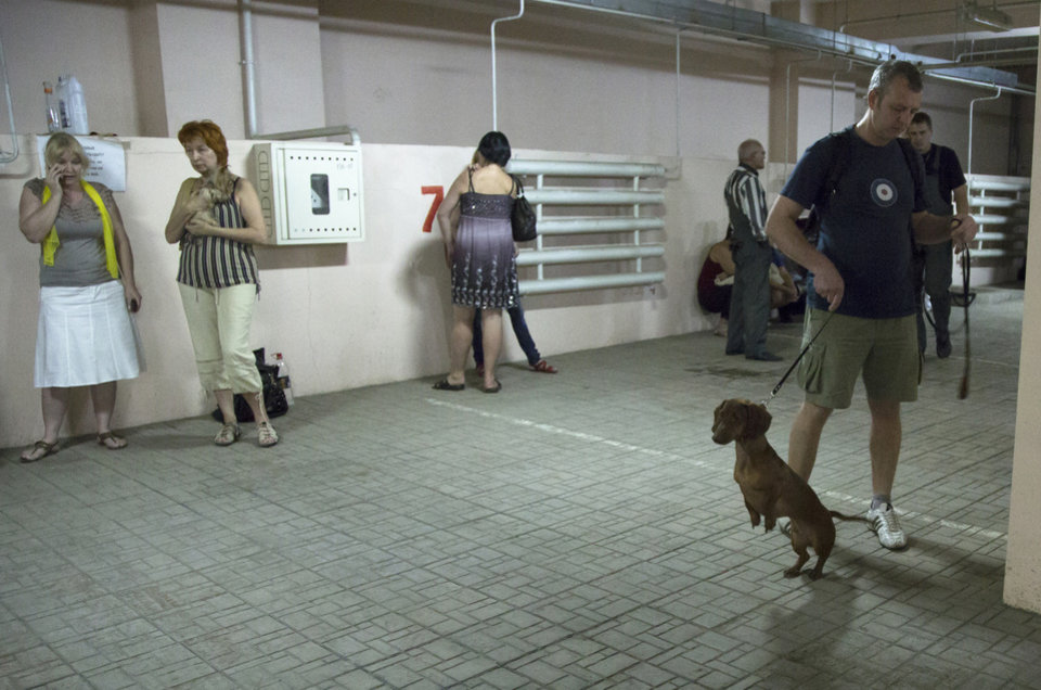Photo - People gather in an underground car park to seek safety from incoming shelling in Donetsk, eastern Ukraine, Tuesday, July 29, 2014. (AP Photo/Dmitry Lovetsky)