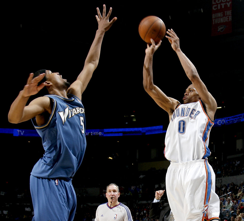Oklahoma City's Russell Westbrook shoots the ball over Washington's Dominic McGuire during the NBA basketball game between the Oklahoma City Thunder and the Washington Wizards at the Ford Center in Oklahoma City, Wed., March 4, 2009. PHOTO BY BRYAN TERRY, THE OKLAHOMAN