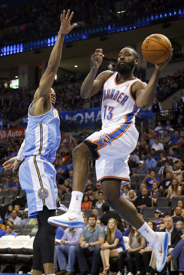 Oklahoma City\'s James Harden (13) passes the ball around Denver\'s Andre Iguodala (9) during the NBA preseason basketball game between the Oklahoma City Thunder and the Denver Nuggets at the Chesapeake Energy Arena, Sunday, Oct. 21, 2012. Photo by Sarah Phipps, The Oklahoman