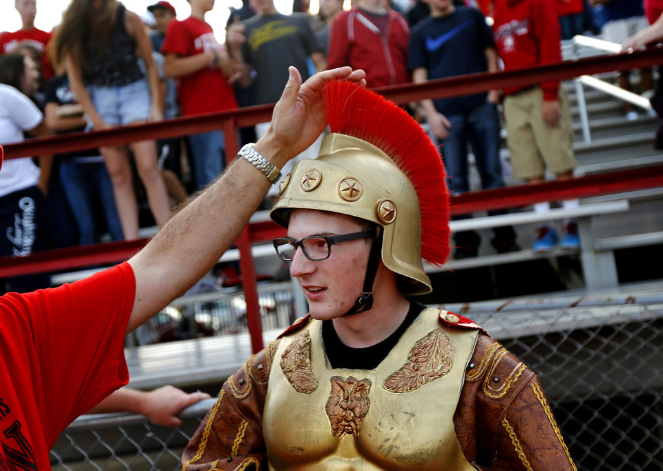 Dressed as the Carl Albert Titan mascot, senior Spenser Powers gets ready for the start of a high school football game between Carl Albert and Coweta at Carl Albert in Midwest City, Friday, September 7, 2012. Photo by Bryan Terry, The Oklahoman