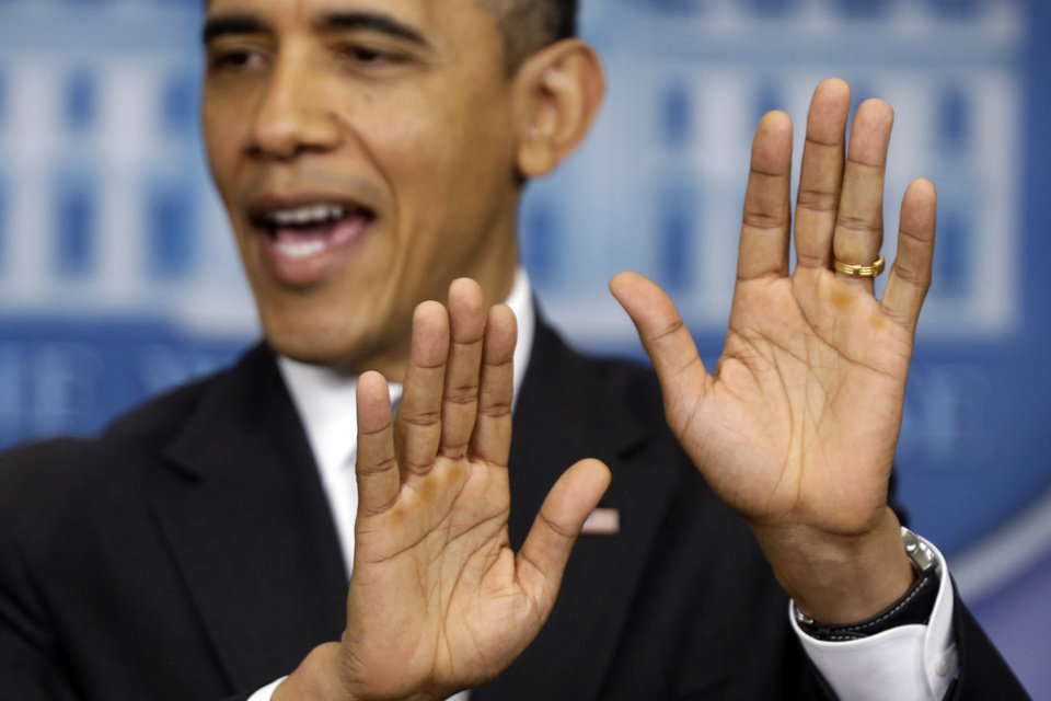 Photo - President Barack Obama gestures as he speaks about negotiations regarding the fiscal cliff as he takes questions from reporters, Wednesday, Dec. 19, 2012, at the White House in Washington. (AP Photo/Charles Dharapak)