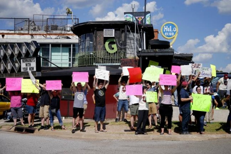 Photo -  A crowd gathers on July 13, 2017, to protest a plan by Braum's Ice Cream & Dairy Stores to rezone and clear out an area near Classen Circle and NW 50. Petitions and appeals organized by mid-century architecture advocate Lynne Rostochil helped convince Braum's to have a change of heart on the matter and the building was saved. [Bryan Terry, The Oklahoman Archives]