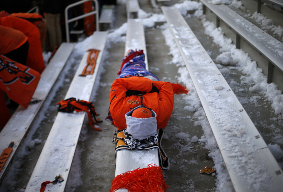 Photo - On OSU fan waits for the Bedlam college football game between the Oklahoma State University Cowboys (OSU) and the University of Oklahoma Sooners (OU) at Boone Pickens Stadium in Stillwater, Okla., Saturday, Dec. 7, 2013. Photo by Bryan Terry, The Oklahoman
