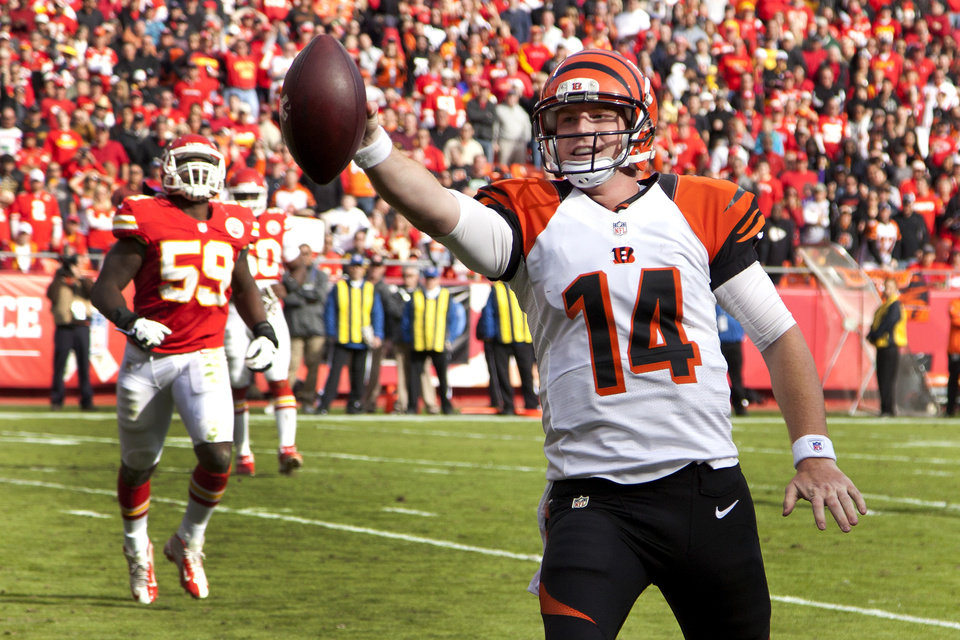 Cincinnati Bengals quarterback Andy Dalton(14) runs into the end zone ahead of Kansas City Chiefs inside linebacker Jovan Belcher to score a touchdown during the first half of a an NFL football game Sunday, Nov. 18, 2012, in Kansas City, Mo. (AP Photo/Josh Adams)