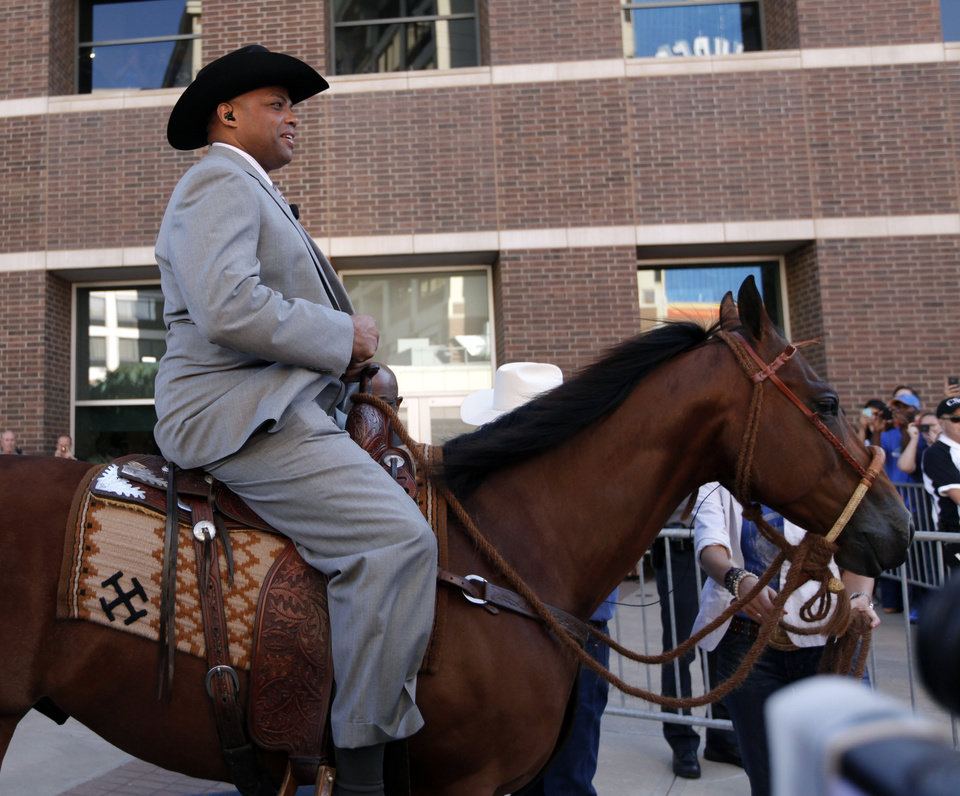 Charles Barkley rides a horse to the TNT set before game three of the Western Conference Finals in the NBA playoffs between the Oklahoma City Thunder and the San Antonio Spurs at Chesapeake Energy Arena in Oklahoma City, Thursday, May 31, 2012. Photo by Sarah Phipps, The Oklahoman