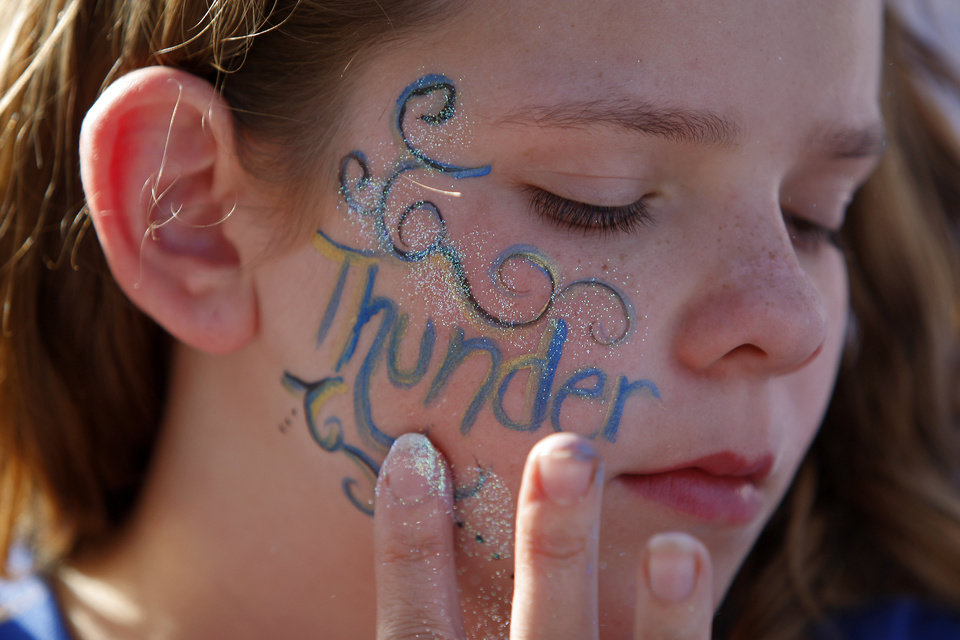 Photo - Daeshawna Gonzalez, 11, of Canton gets her face decorated before Game 5 in the second round of the NBA playoffs between the Oklahoma City Thunder and the L.A. Lakers at Chesapeake Energy Arena in Oklahoma City, Monday, May 21, 2012. Photo by Bryan Terry, The Oklahoman