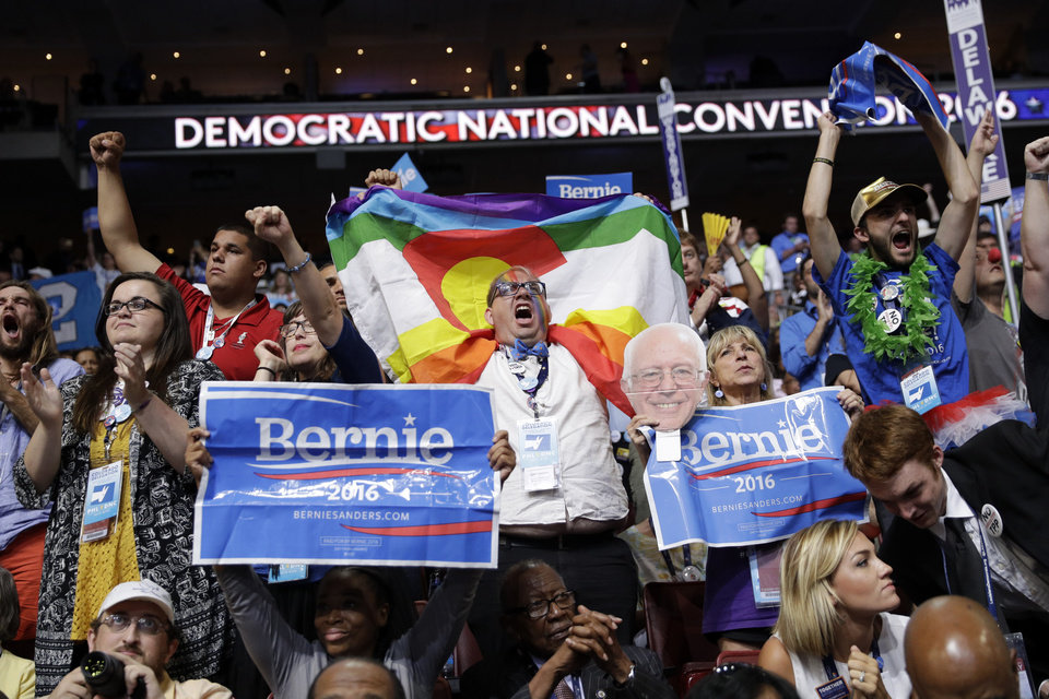 Photo - Colorado delegates cheer before the start of the second day session of the Democratic National Convention in Philadelphia, Tuesday, July 26, 2016. (AP Photo/John Locher)