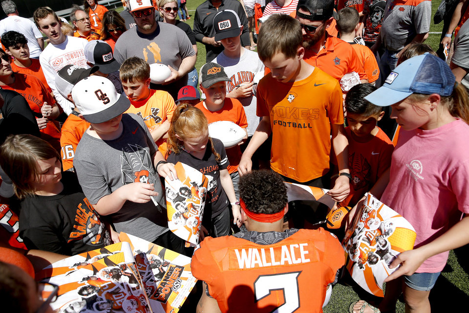 Photo - Oklahoma State's Tylan Wallace (2) signs autographs for fans during the Oklahoma State Cowboys spring practice at Boone Pickens Stadium in Stillwater, Okla., Saturday, April 20, 2019.  Photo by Sarah Phipps, The Oklahoman