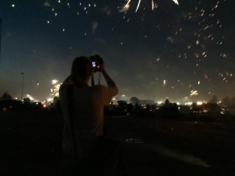 Photo - Videographer Luke Spencer capturing the craziness of Mustang Fireworks.