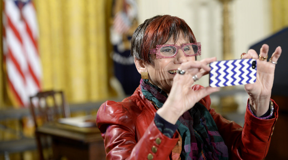 Photo - Rep. Rosa DeLauro, D-Conn. takes a photo in the East Room of the White House in Washington, Tuesday, April 8, 2014, before an event marking Equal Pay Day. President Barack Obama announced new executive actions to strengthen enforcement of equal pay laws for women. The president and his Democratic allies in Congress are making a concerted election-year push to draw attention to women's wages. (AP Photo/Susan Walsh)