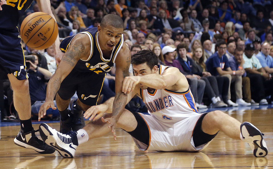 Photo - Oklahoma City Thunder's Nick Collison (4) passes the ball while being defended by Utah Jazz's Earl Watson (11) during the NBA basketball game between the Oklahoma City Thunder and the Utah Jazz at Chesapeake Energy Arena on Wednesday, March 13, 2013, in Oklahoma City, Okla. Photo by Chris Landsberger, The Oklahoman