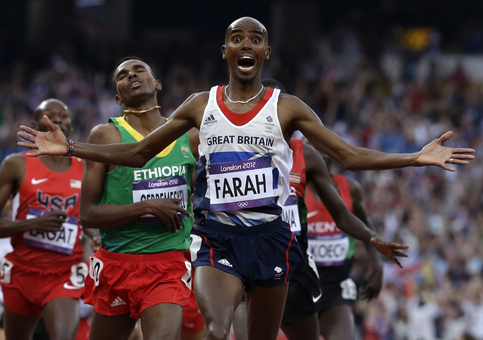 Photo -   Britain's Mohamed Farah celebrates as he crosses the finish line to win the men's 5000-meter final during the athletics in the Olympic Stadium at the 2012 Summer Olympics, London, Saturday, Aug. 11, 2012.(AP Photo/Anja Niedringhaus)