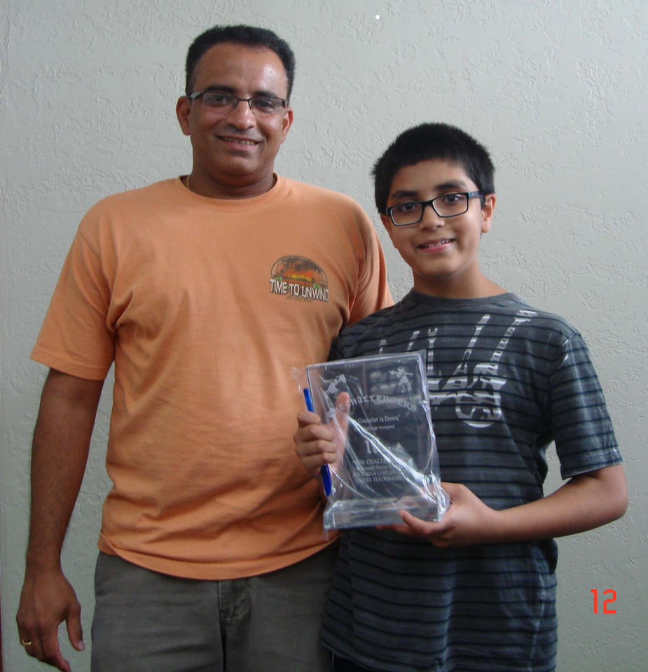 Photo -  Advait Patel, 11, poses with his father, Rupal, after winning the Challengers Chess Club July Open earlier this month. Patel is ranked No. 2 nationally at his age. PHOTO PROVIDED      -