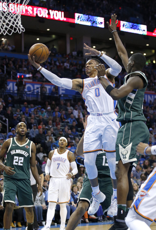 Photo -  Oklahoma City's Russell Westbrook shoots a layup as Milwaukee's Tony Snell  defends during Friday's game between the Oklahoma City Thunder and the Milwaukee Bucks at the Chesapeake Energy Arena. The Bucks won, 97-95. [Photo by Sarah Phipps, The Oklahoman]