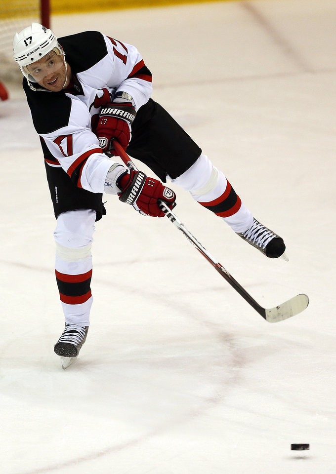 New Jersey Devils left wing Ilya Kovalchuk, of Russia, passes the puck during a scrimmage against the Albany Devils, the team's AHL farm team, Wednesday, Jan. 16, 2013, in Newark, N.J. (AP Photo/Julio Cortez)