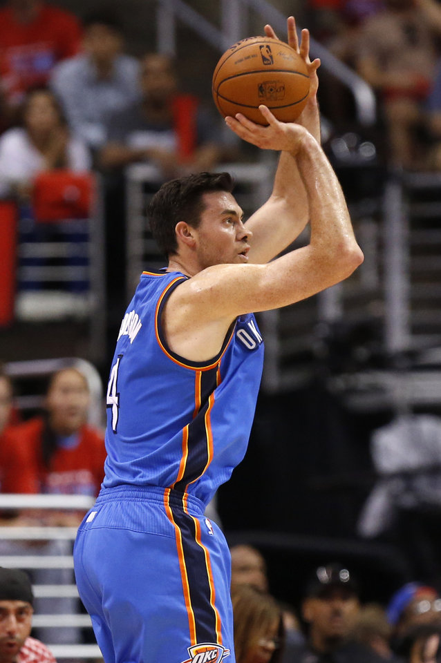 Photo - Oklahoma City's Nick Collison (4) shoots and makes a 3-point shot during Game 6 of the Western Conference semifinals in the NBA playoffs between the Oklahoma City Thunder and the Los Angeles Clippers at the Staples Center in Los Angeles, Thursday, May 15, 2014. Photo by Nate Billings, The Oklahoman