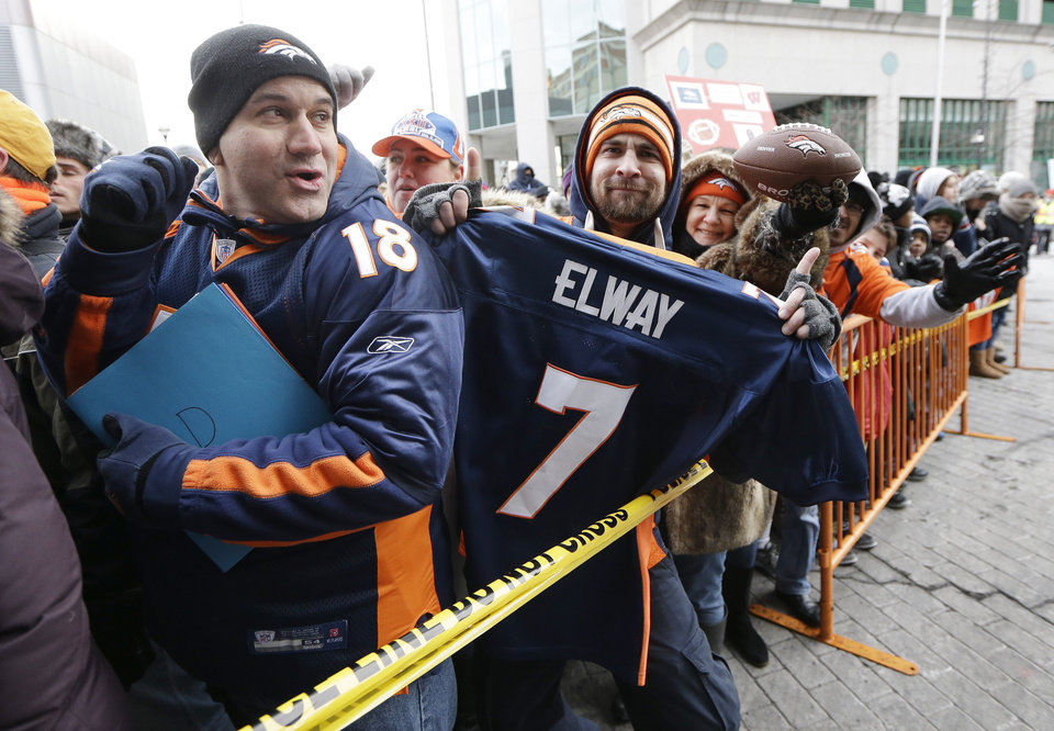 Photo - Denver Broncos fans wait for players to arrive at the team hotel Sunday, Jan. 26, 2014, in Jersey City, N.J. The Broncos are scheduled to play the Seattle Seahawks in the NFL Super Bowl XLVIII football game Sunday, Feb. 2, in East Rutherford, N.J. (AP Photo/Mark Humphrey)