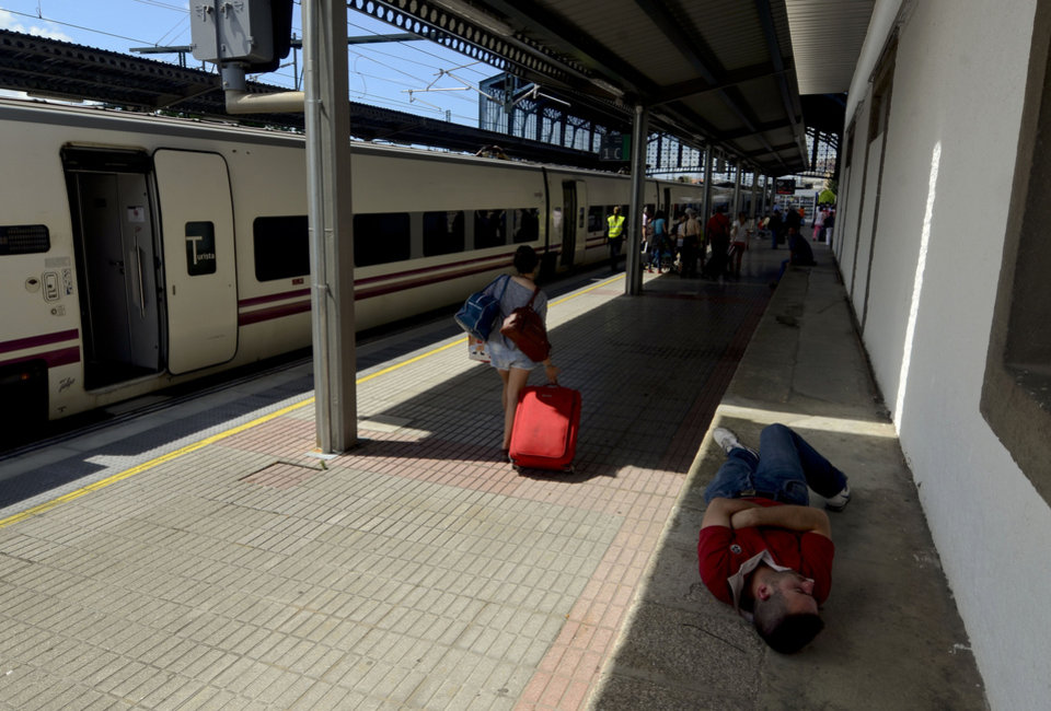 "Photo - Passengers leave an 'Alvia' type train after it arrived at the station in Santiago de Compostela, Spain, Friday July 26, 2013. The 'Alvia' train, the same as the one that crashed Wednesday is the first to operate on this line after the accident. Investigators have taken possession of the ""black boxes"" of the Spain train that hurtled at high-speed along a curve and derailed, killing 80 people, a court official said Friday. Analysis will be performed to determine why the train was traveling far above the speed limit when it crashed near a station in Santiago de Compostela, in the northwestern Galicia region, said court spokeswoman Maria Pardo Rios. The train's operator remained hospitalised Friday and will be questioned by police but she said the interview will not happen Friday. (AP Photo/Brais Lorenzo)"
