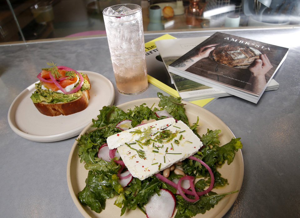 Photo -  White Bean Herb salad with feta cheese and Avocado and Egg Toast with smoked salmon from The Kitchen at Commonplace Books in Oklahoma City. [Photo by Sarah Phipps, The Oklahoman]