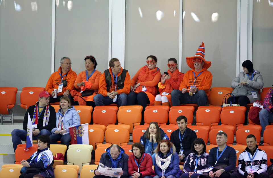 Photo - Empty seats are seen as Dutch skating fans wait for the start of the men's 5,000-meter speedskating race at the Adler Arena Skating Center at the 2014 Winter Olympics in Sochi, Russia, Saturday, Feb. 8, 2014. (AP Photo/Matt Dunham)