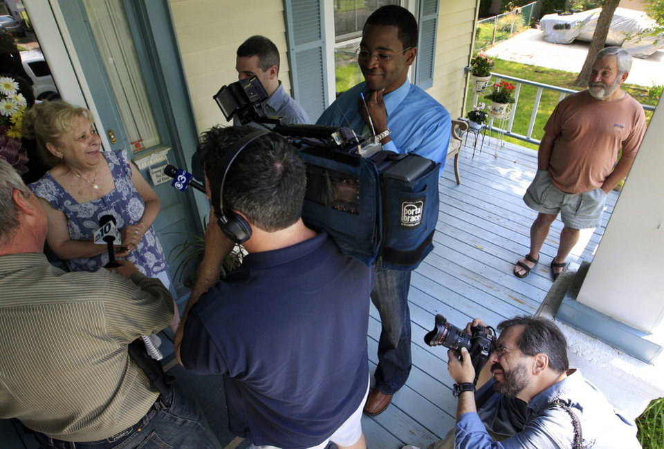 Maryanne Hammel, second left, and husband Richard Hammel, right back, answers questions about their neighbor, Pedro Hernandez, who lives at 116 E. Linwood Ave., Apt. B, in Maple Shade, N.J., Thursday, May 24, 2012. Hernandez has implicated himself in the death of 6-year-old Etan Patz, who disappeared 33 years ago in New York, police said Thursday. (AP Photo/Mel Evans)