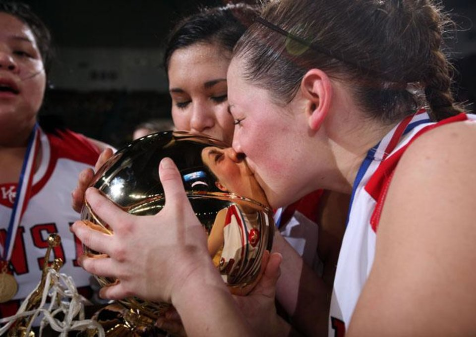 Photo -  Kelsey Barnwell kisses the championship trophy during the Class 3A girls high school basketball state tournament final between Kansas and Millwood Saturday, March 13, 2010, at the State Fair Arena, in Oklahoma City. Photo by Sarah Phipps, The Oklahoman  ORG XMIT: KOD