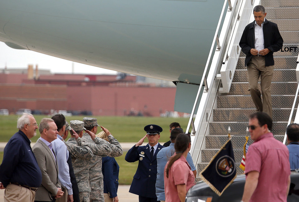 Photo - President Barack Obama arrives at Tinker Air Force base in Midwest City, Sunday, May 26, 2013. Obama was in town to visit areas damaged by the May 20 tornado. Photo by Sarah Phipps, The Oklahoman