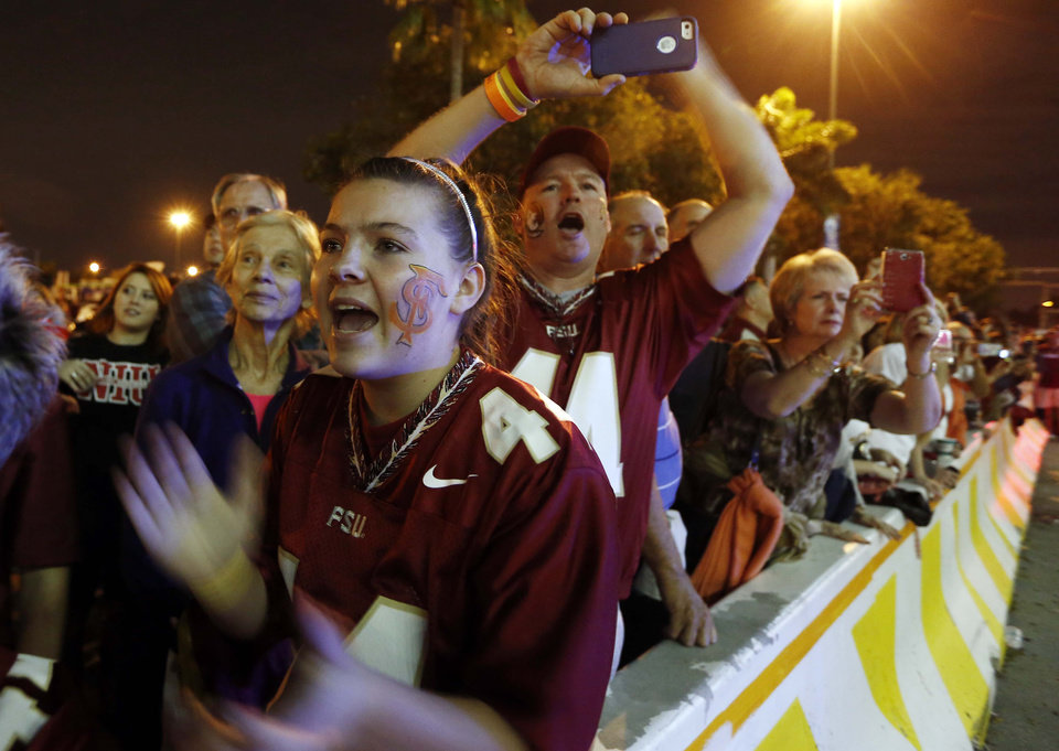 Florida State fans cheer the arrival of the team before the Orange Bowl NCAA college football game against Northern Illinois, Tuesday, Jan. 1, 2013, in Miami. (AP Photo/J Pat Carter)