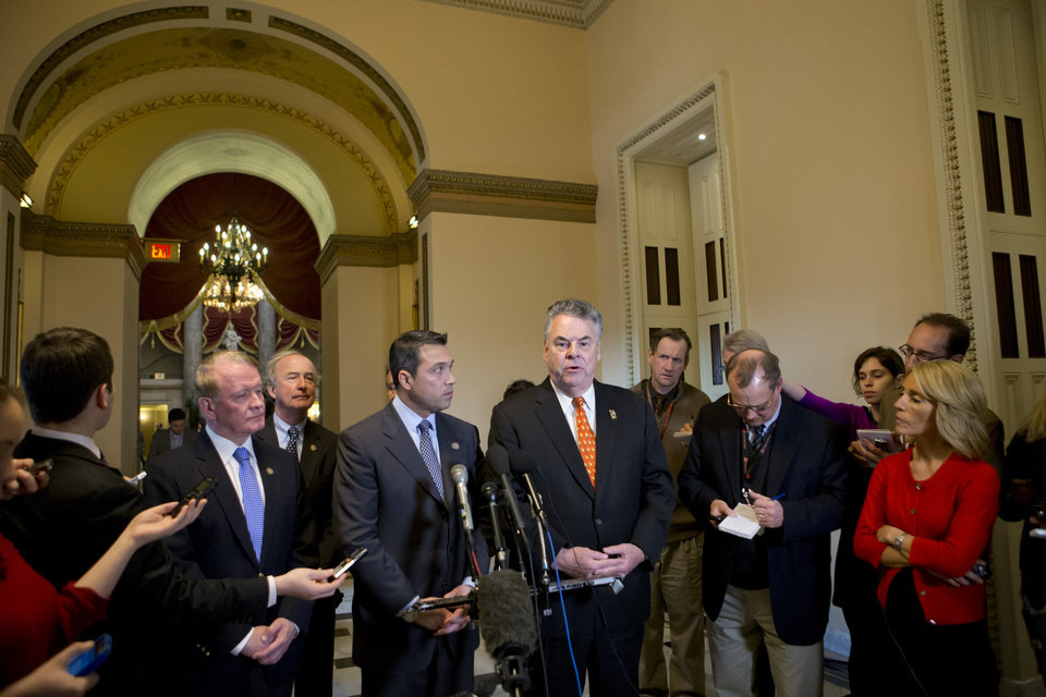 Republican Congressman Peter King of New York, center, and other lawmakers speak to reporters after a meeting with House Speaker John Boehner, R-Ohio, over the delayed vote on aid for the victims of Superstorm Sandy, at the Capitol in Washington, Wednesday, Jan. 2, 2013. King says the speaker will schedule a vote Friday for $9 billion in flood insurance and another on Jan. 15 for a remaining $51 billion in the package. Boehner's decision to cancel an expected vote Tuesday night had outraged lawmakers from New York, New Jersey and elsewhere, including many in his own party. From right to left are: Rep. Peter King, R-NY, Reps. Michael Grimm, R-NY, Rep. Rodney Frelinghuysen, R-NJ, and Rep. Leonard J. Lance, R-NJ.  (AP Photo/J. Scott Applewhite)