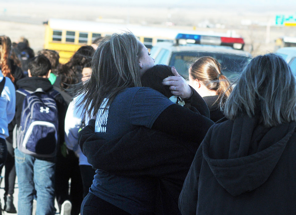 Photo - Students are escorted from Berrendo Middle School following a shooting, Tuesday, Jan. 14, 2014, in Roswell, N.M. Roswell police said the suspected shooter was arrested the school, but authorities have not said if there were any injuries. The school has been placed on lockdown. No other details are yet available. (AP Photo/Roswell Daily Record, Mark Wilson)