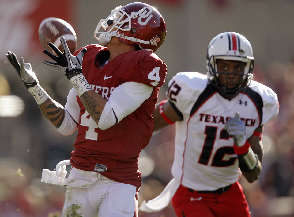 Photo - Oklahoma's Kenny Stills (4) makes a reception for a touchdown in front of Texas Tech's D.J. Johnson (12) during the first half of the college football game between the University of Oklahoma Sooners (OU) and the Texas Tech Red Raiders (TTU) at the Gaylord Family Memorial Stadium on Saturday, Nov. 13, 2010, in Norman, Okla.  Photo by Chris Landsberger, The Oklahoman