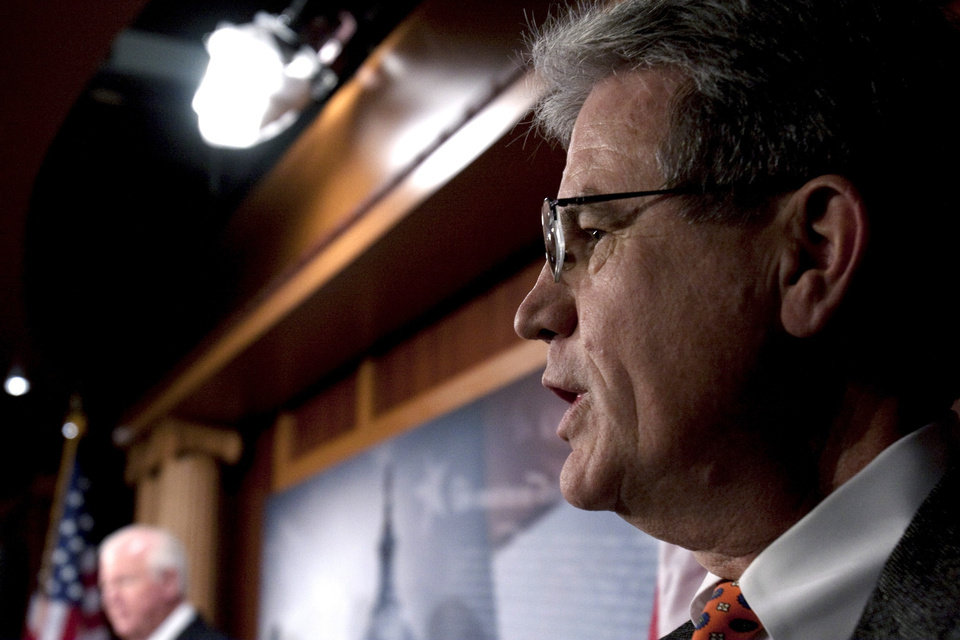 Photo - Sen. Tom Coburn, R-Muskogee, is seen at a news conference on Capitol Hill in Washington, Saturday, Dec. 19, 2009. (AP Photo/Harry Hamburg)