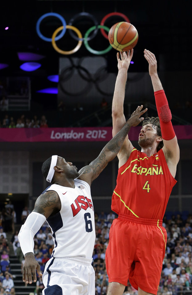 Spain's Pau Gasol shoots over United States' LeBron James during a men's gold medal basketball game at the 2012 Summer Olympics, Sunday, Aug. 12, 2012, in London. (AP Photo/Eric Gay)