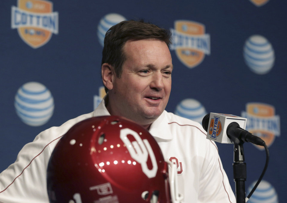 Oklahoma coach Bob Stoops speaks during media day for the Cotton Bowl NCAA college football game at Cowboys Stadium, Sunday, Dec. 30, 2012, in Arlington, Texas. Oklahoma faces Texas A&M on Jan. 4. (AP Photo/LM Otero) ORG XMIT: TXMO108