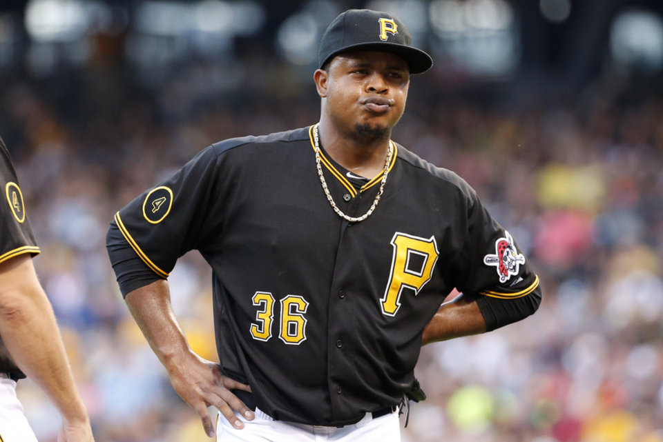 Photo - Pittsburgh Pirates starting pitcher Edinson Volquez (36) collects himself on the mound during the second inning of a baseball game against the Los Angeles Dodgers in Pittsburgh Monday, July 21, 2014. (AP Photo/Gene J. Puskar)