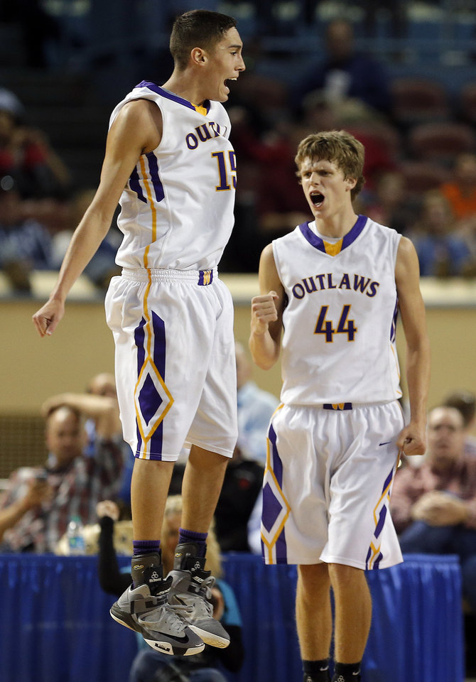 Photo - Weleetka's Jackson Frye, left, and Caleb Wittman celebrate during the Class A boys state championship between Glencoe and Weleetka  at the State Fair Arena.,  Saturday, March 2, 2013. Photo by Sarah Phipps, The Oklahoman